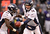 Denver Broncos quarterback Peyton Manning (18) hands off to Denver Broncos running back Ronnie Hillman (21) during the fourth quarter Sunday, December 16, 2012 at M&T Bank Stadium. John Leyba, The Denver Post