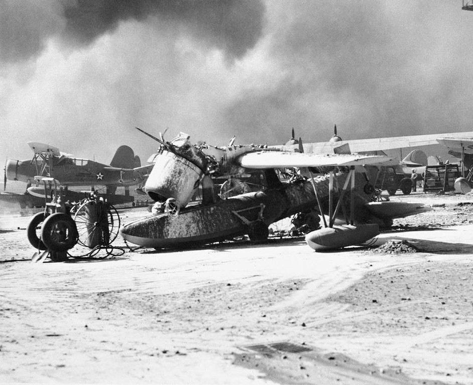 Description of . In this photo provided by the U.S. Navy, one of 80 U.S. Navy planes wrecked in the Japanese attack on Pearl Harbor, this observation scout seaplane has engine ripped from its housing, Dec. 7, 1941. (AP Photo/U.S. Navy)