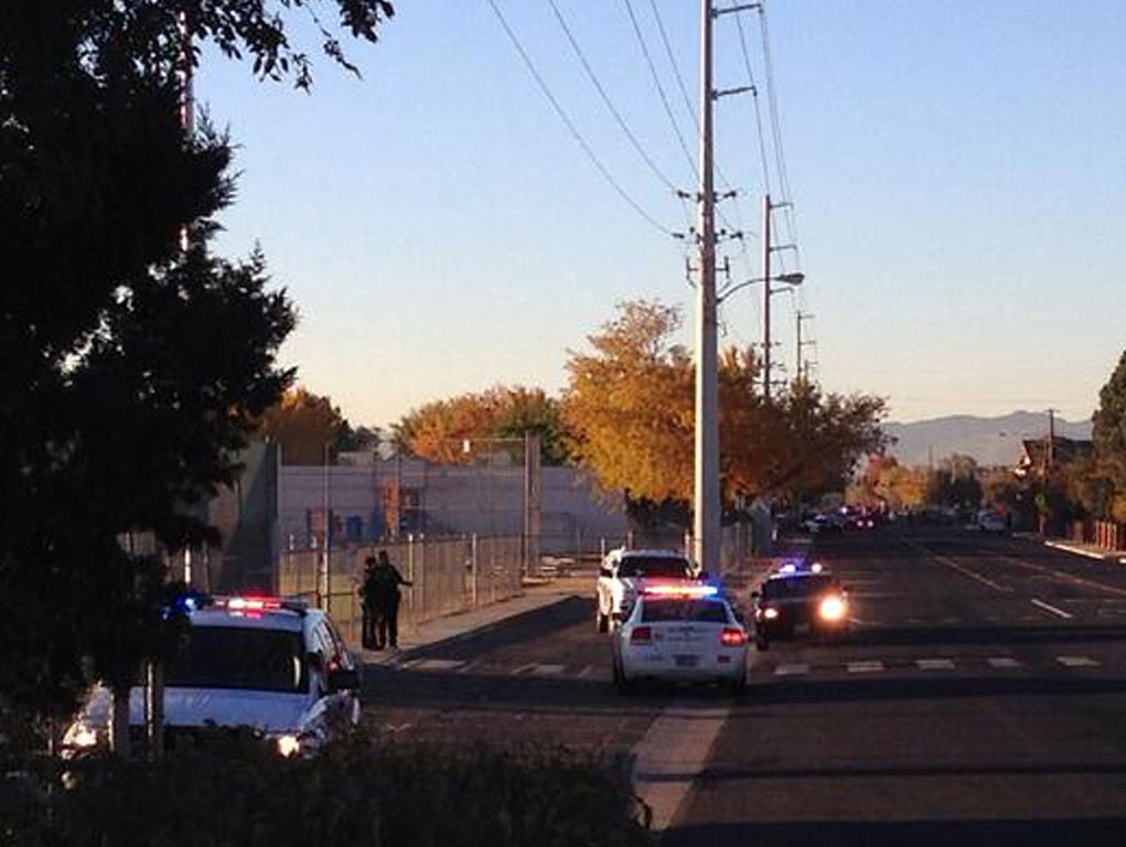 Description of . In this photo provided by Jerry Davis, police gather near Sparks Middle School after a shooting at the school, Monday, Oct. 21, 2013, in Reno, Nev.  (AP Photo/Jerry Davis)