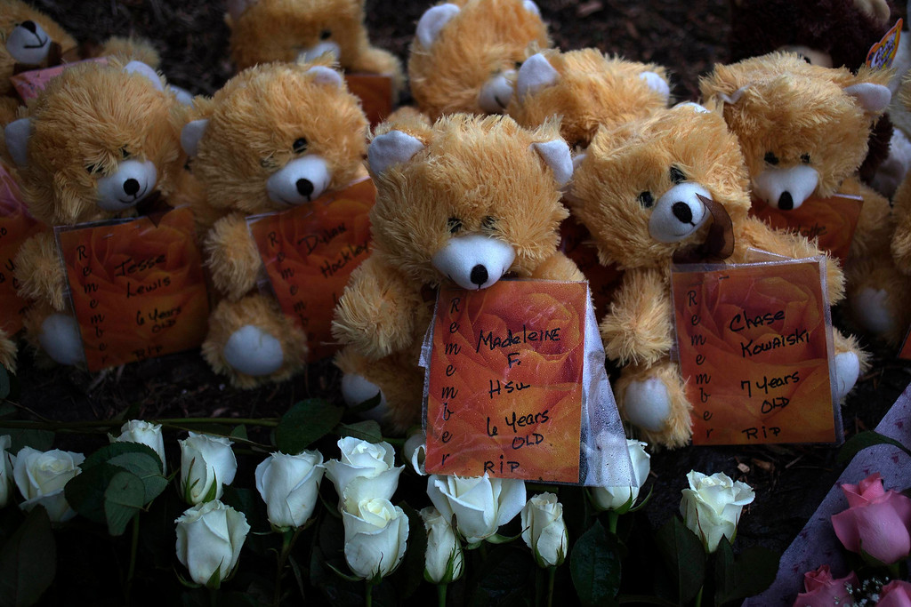 Description of . The names of victims from the Sandy Hook Elementary shooting are placed on teddy bears left at a memorial in Sandy Hook Village in Newtown, Connecticut December 16, 2012. Worshippers filled Sunday services to mourn the victims of a gunman's elementary school rampage that killed 20 children and six adults with the president due to appear later at an interfaith vigil to help this shattered Connecticut town recover.  REUTERS/Adrees Latif