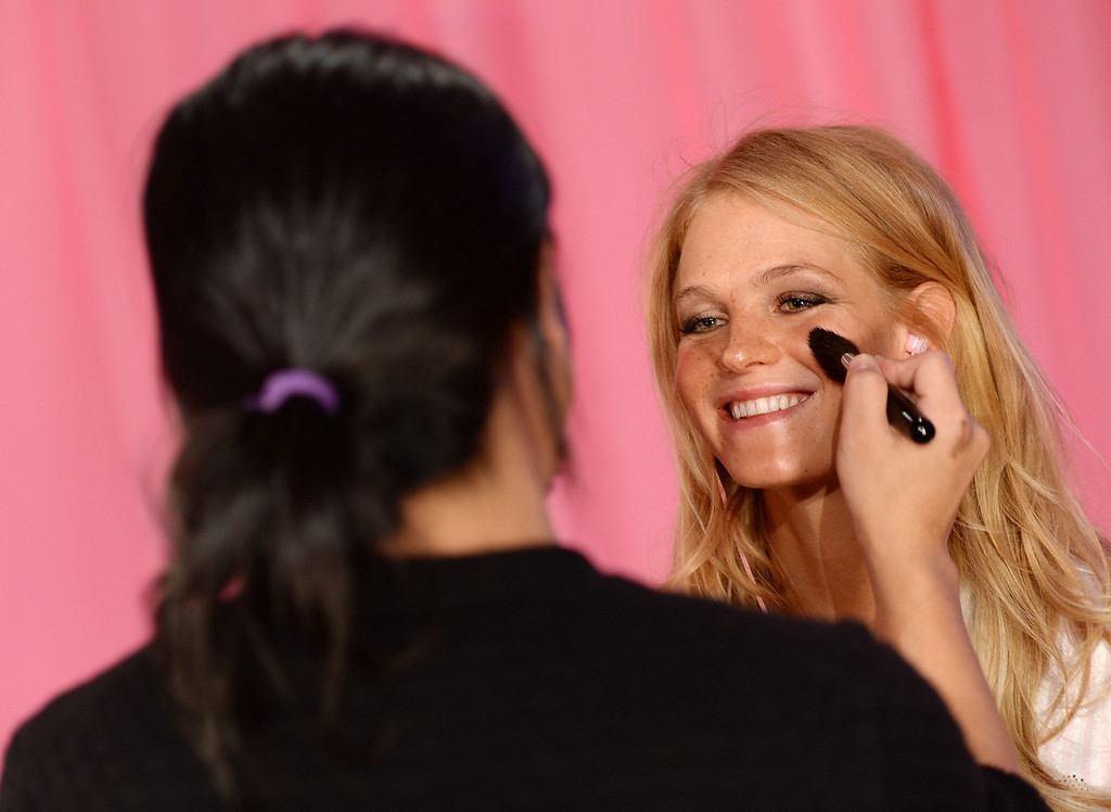 Description of . Model Erin Heatherton prepares at the 2013 Victoria's Secret Fashion Show hair and make-up room at Lexington Avenue Armory on November 13, 2013 in New York City.  (Photo by Dimitrios Kambouris/Getty Images for Victoria's Secret)