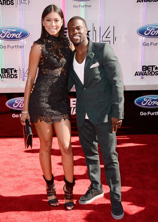 Description of . Torrei Hart, left, and Kevin Hart arrive at the BET Awards at the Nokia Theatre on Sunday, June 29, 2014, in Los Angeles. (Photo by Dan Steinberg/Invision/AP)