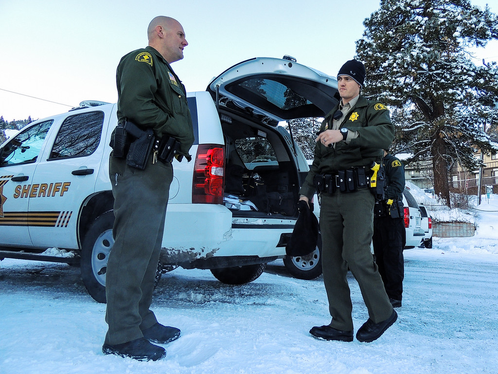 Description of . Sheriff's deputies complete their shift and return to the command post at Bear Mountain Resort at start of day four in the search for fugitive ex-cop Christopher Dorner in Big Bear on Sunday, Feb. 10, 2013. (Rachel Luna / Staff Photographer)