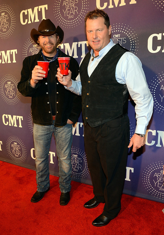 Description of . Toby Keith and Roger Clemens attend 2012 CMT Artists Of The Year at The Factory at Franklin on December 3, 2012 in Franklin, Tennessee.  (Photo by Rick Diamond/Getty Images for CMT)