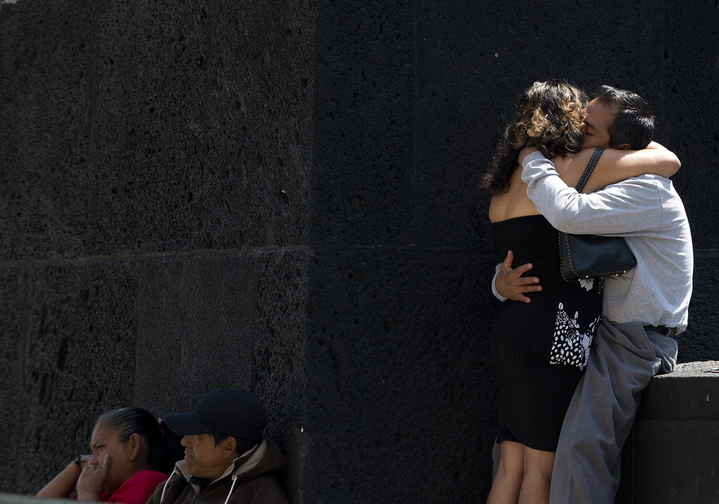 Description of . A couple kisses on St Valentine's Day at the Republic Square in Mexico City on February 14, 2013.  AFP PHOTO/Yuri CORTEZ/AFP/Getty Images