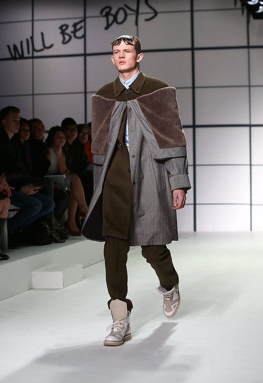 . A model on the catwalk during the Xander Zhou show at the London Collections: MEN AW13 at The Hospital Club on January 9, 2013 in London, England.  (Photo by Tim Whitby/Getty Images)