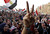 Women shout during a protest in Tahrir Square in Cairo January 25, 2013. Protesters clashed with police across Egypt on Friday on the second anniversary of the revolt that toppled Hosni Mubarak, taking to the streets against the elected Islamist president who they accuse of betraying the revolution. REUTERS/Mohamed Abd El Ghany