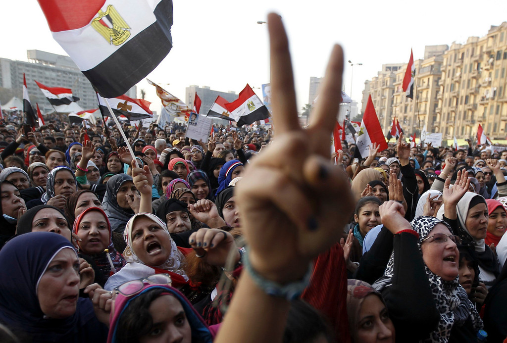 . Women shout during a protest in Tahrir Square in Cairo January 25, 2013. Protesters clashed with police across Egypt on Friday on the second anniversary of the revolt that toppled Hosni Mubarak, taking to the streets against the elected Islamist president who they accuse of betraying the revolution. REUTERS/Mohamed Abd El Ghany