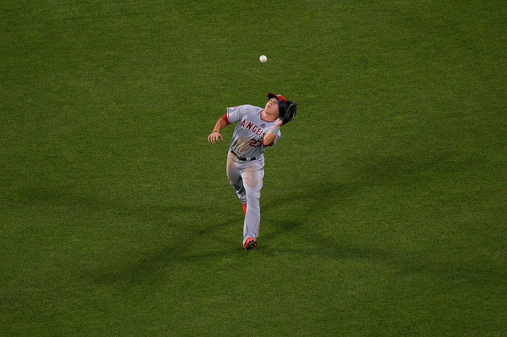 . American League All-Star Mike Trout #27 of the Los Angeles Angels of Anaheim makes a catch in the outfield during the 84th MLB All-Star Game on July 16, 2013 at Citi Field in the Flushing neighborhood of the Queens borough of New York City.  (Photo by Drew Hallowell/Getty Images)