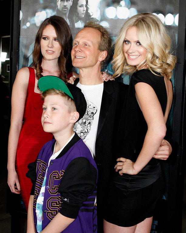 Description of . Danish director Niels Arden Oplev poses with his children (L-R) Linea, Thoreau and Anna at the premiere of his new film