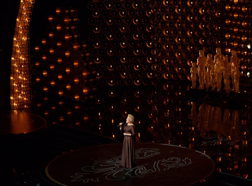 Description of . Bette Midler performs during the Oscars at the Dolby Theatre on Sunday, March 2, 2014, in Los Angeles.  (Photo by John Shearer/Invision/AP)