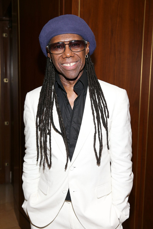 Description of . Musician Nile Rodgers attends the Warner Music Group annual GRAMMY celebration on January 26, 2014 in Los Angeles, California.  (Photo by Imeh Akpanudosen/Getty Images for Warner Bros.)