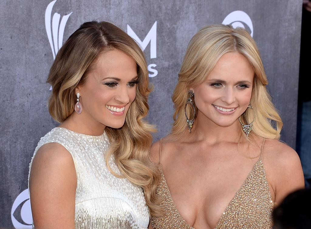 Description of . Singer/songwriter Carrie Underwood (L) and musician Miranda Lambert attend the 49th Annual Academy Of Country Music Awards at the MGM Grand Garden Arena on April 6, 2014 in Las Vegas, Nevada.  (Photo by Jason Merritt/Getty Images)