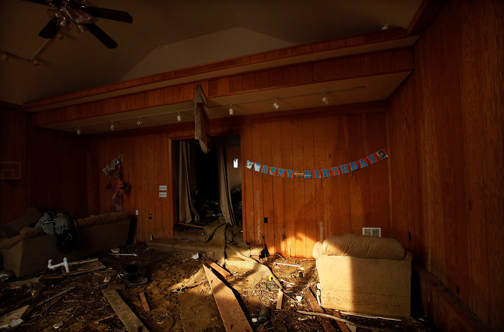 Description of . A house damaged by the storm surge during Superstorm Sandy is seen one month after the disaster at the zone of Union Beach, New Jersey, November 29, 2012. REUTERS/Eduardo Munoz