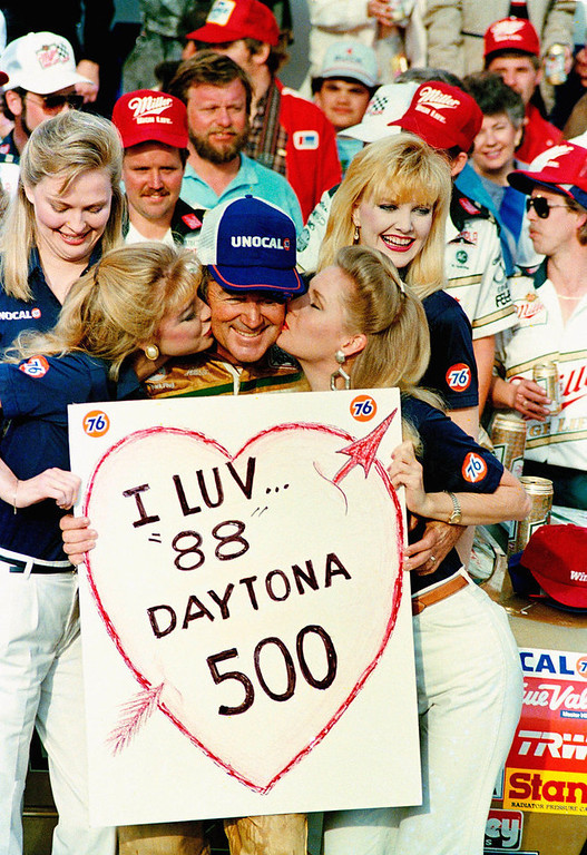 Description of . Bobby Allison, from Hueytown, Ala., gets victory\'s reward after winning the Daytona 500 auto race in Daytona Beach, Fla., Feb. 15, 1988. (AP Photo/Walt Chernokal)