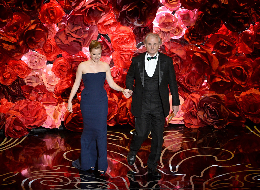 Description of . Actors Amy Adams (L) and Bill Murray speak onstage during the Oscars at the Dolby Theatre on March 2, 2014 in Hollywood, California.  (Photo by Kevin Winter/Getty Images)