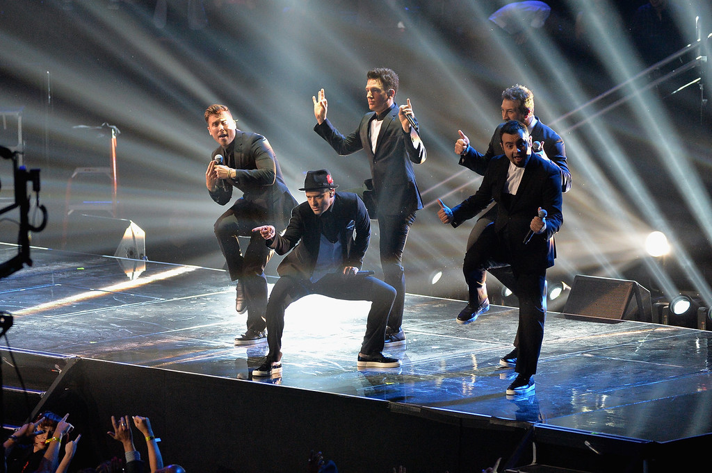 Description of . (L-R) Chris Kirkpatrick, Joey Fatone, Justin Timberlake, JC Chasez and Lance Bass of 'N Sync perform during the 2013 MTV Video Music Awards at the Barclays Center on August 25, 2013 in the Brooklyn borough of New York City.  (Photo by Rick Diamond/Getty Images for MTV)