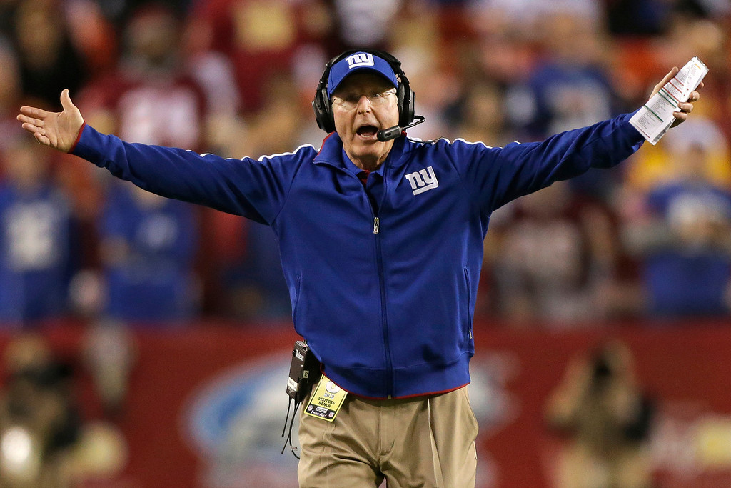Description of . New York Giants head coach Tom Coughlin reacts to a call during the first half of an NFL football game against the Washington Redskins in Landover, Md., Monday, Dec. 3, 2012. (AP Photo/Evan Vucci)