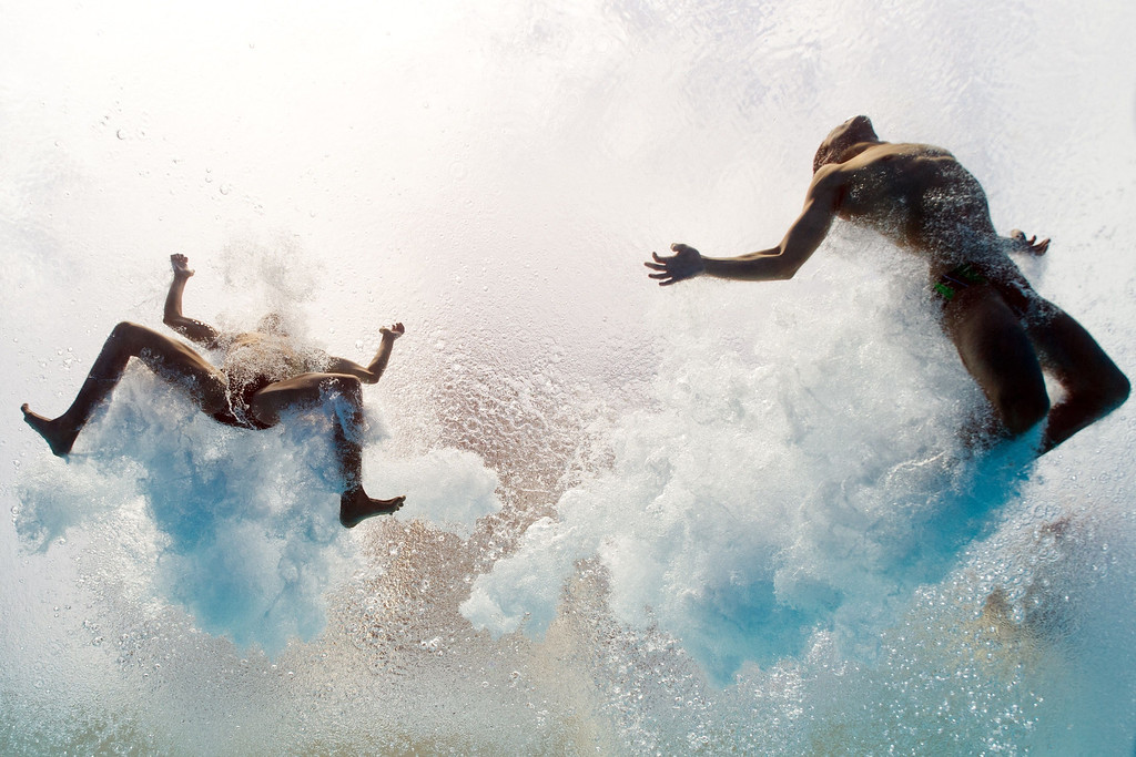 Description of . Mexico's Ivan Garcia and German Sanchez enter the water as they compete in the men's 10-metre synchro platform preliminary diving event in the FINA World Championships at the Piscina Municipal de Montjuic in Barcelona on July 21, 2013.  FRANCOIS XAVIER MARIT/AFP/Getty Images