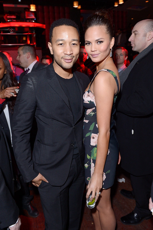 Description of . NEW YORK, NY - FEBRUARY 12: Musician John Legend and model Chrissy Teigen attend as Sports Illustrated celebrates SI Swimsuit 2013 with a star-studded kickoff event at Crimson on February 12, 2013 in New York City.  (Photo by Michael Loccisano/Getty Images for Sports Illustrated)