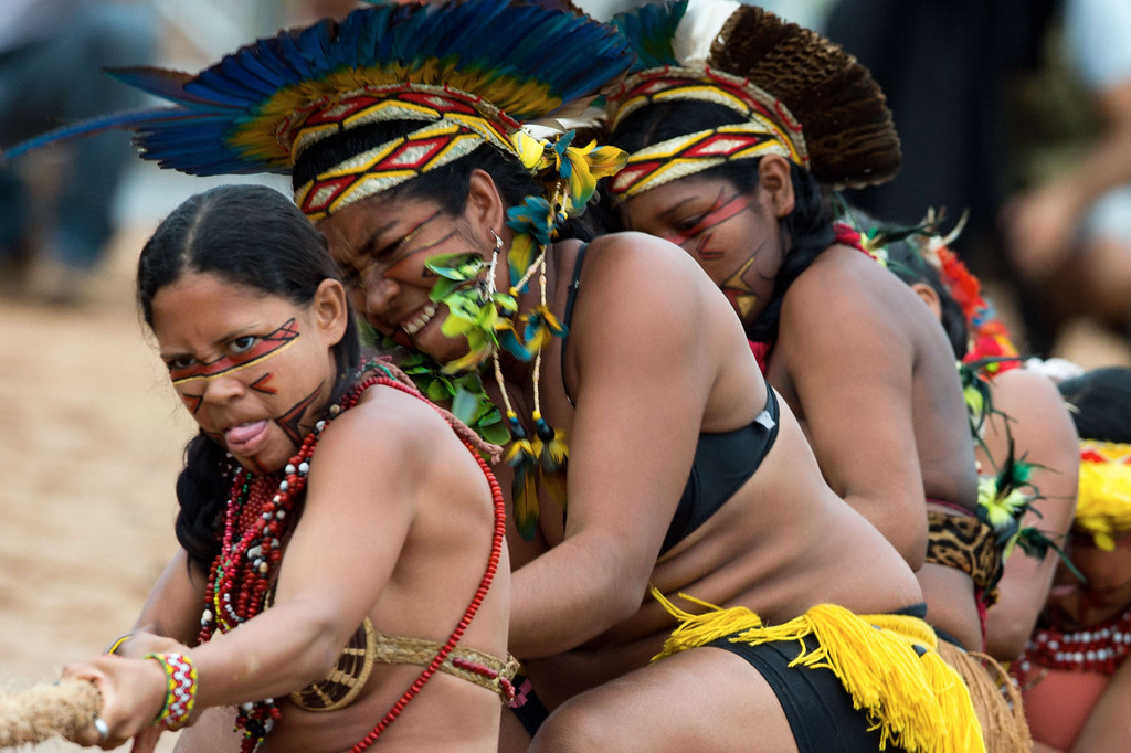 Description of . Brazilian indigenous women of the Pataxo tribe participate in a tug of war competition during the XII International Games of Indigenous Peoples in Cuiaba, Mato Grosso state, Brazil on November 12, 2013. AFP PHOTO / Christophe SIMON/AFP/Getty Images