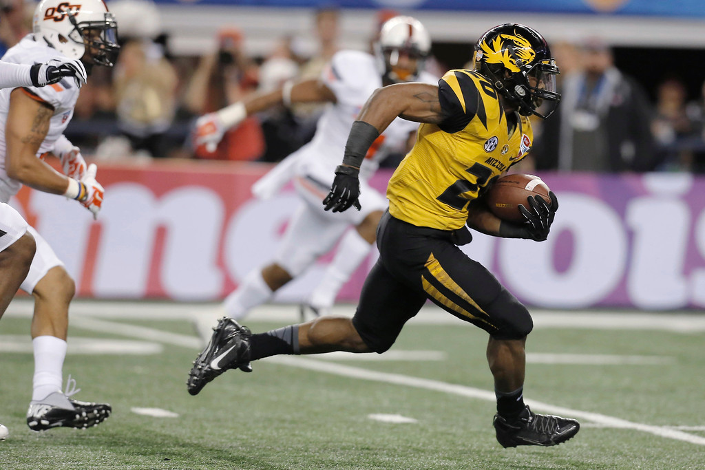 Description of . Missouri running back Henry Josey (20) goes in for a touchdown against Oklahoma State during the second half of the Cotton Bowl NCAA college football game, Friday, Jan. 3, 2014, in Arlington, Texas. (AP Photo/Brandon Wade)