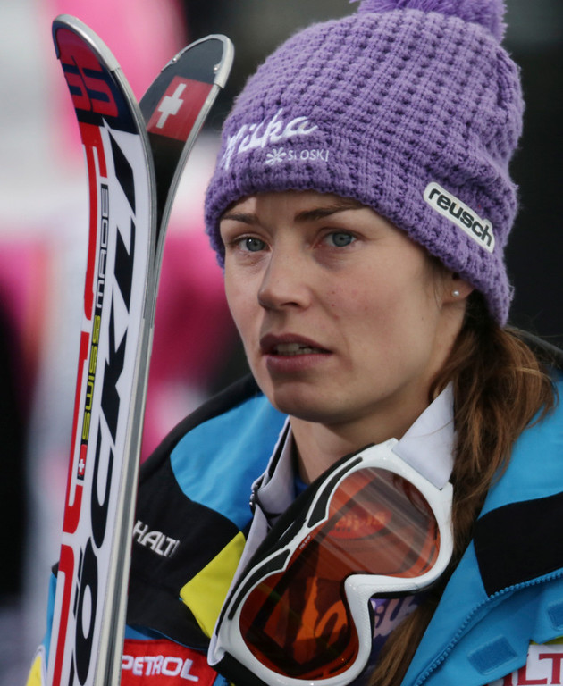 Description of . Slovenia\'s Tina Maze reacts after learning that United States\' Lindsey Vonn crashed during the women\'s super-G at the Alpine skiing world championships in Schladming, Austria, Tuesday, Feb.5,2013. (AP Photo/Matthias Schrader)