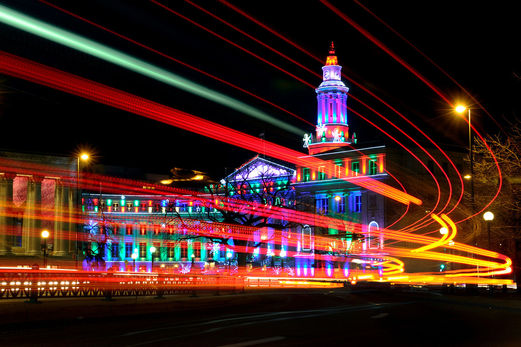 Description of . Denver's City and County Building was illuminated for the season Thursday night, December 6, 2012.  Vehicles passing by on westbound Colfax Avenue left a trail of lights during this time-exposure photograph. Karl Gehring/The Denver Post
