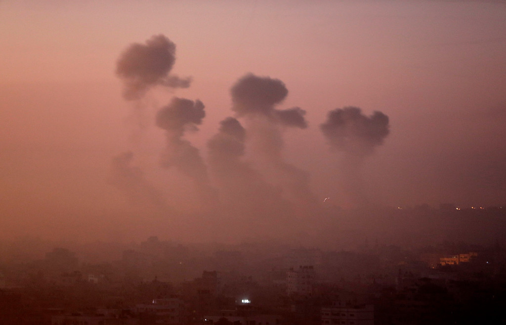 Description of . Smoke rises in the skyline from Israeli strikes in eastern Gaza City, early Wednesday, July 30, 2014, amid Israel's heaviest air and artillery assault in more than three weeks of Israel-Hamas fighting. (AP Photo/Khalil Hamra)