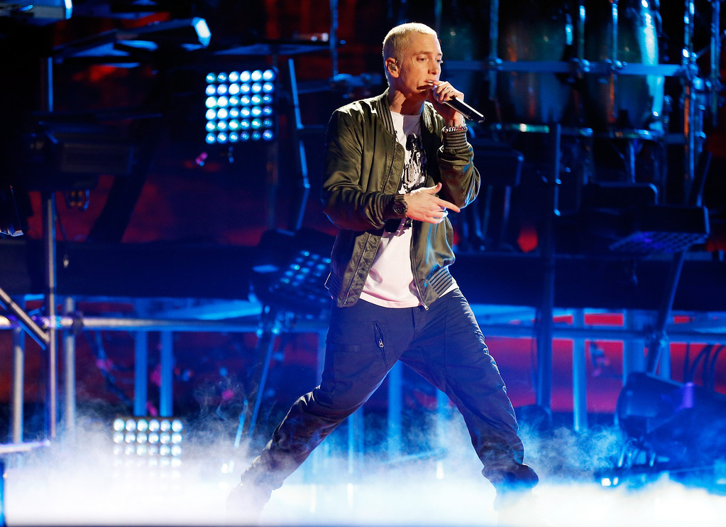 Description of . Recording artist Eminem performs onstage at the 2014 MTV Movie Awards at Nokia Theatre L.A. Live on April 13, 2014 in Los Angeles, California.  (Photo by Christopher Polk/Getty Images for MTV)