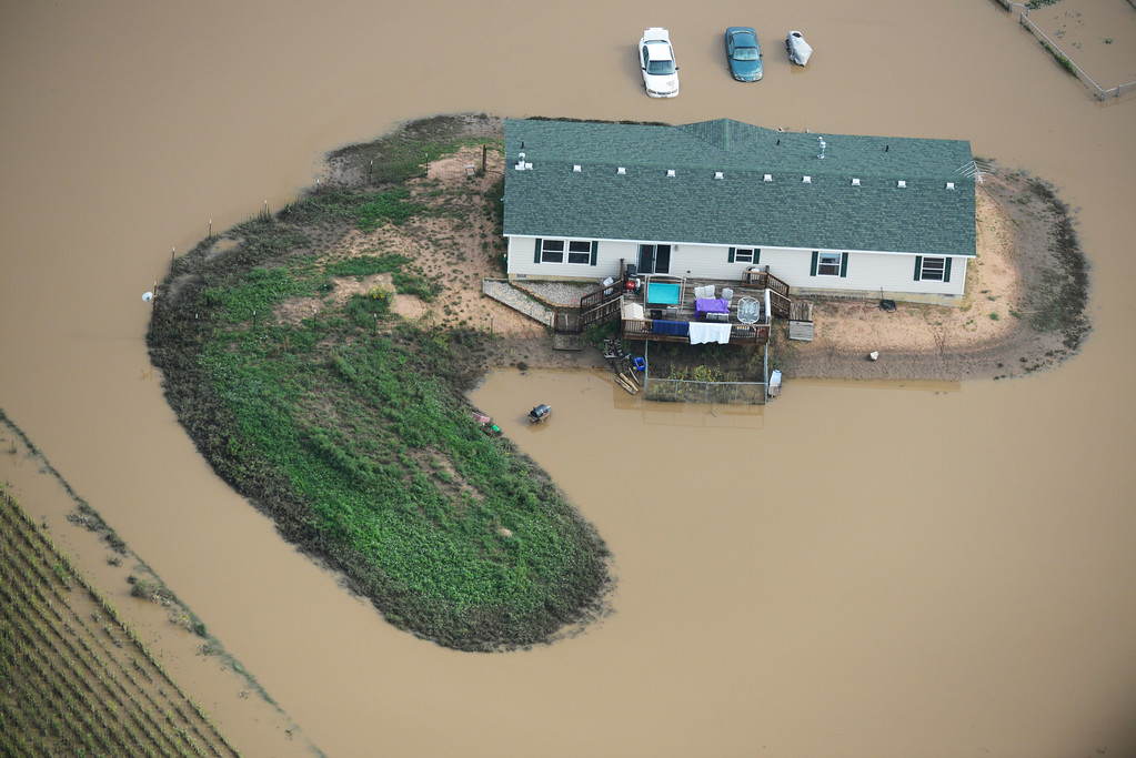 Description of . A home surrounded by flood water on a farm in Weld County Colorado Saturday morning, September 14, 2103. (Photo By Andy Cross/The Denver Post)