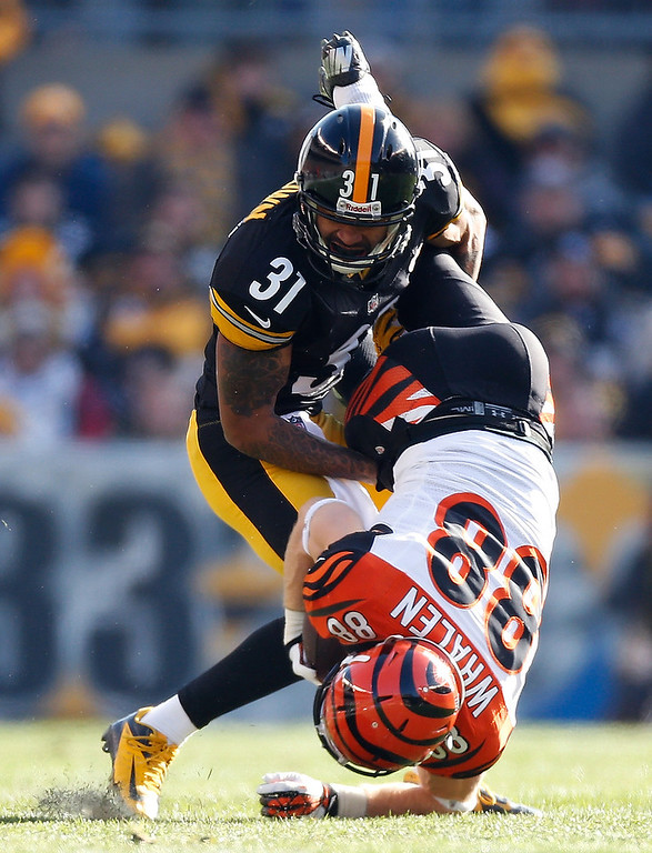 Description of . Ryan Whalen #88 of the Cincinnati Bengals is tackled by Curtis Brown #31 of the Pittsburgh Steelers after a first quarter catch at Heinz Field on December 23, 2012 in Pittsburgh, Pennsylvania. (Photo by Gregory Shamus/Getty Images)