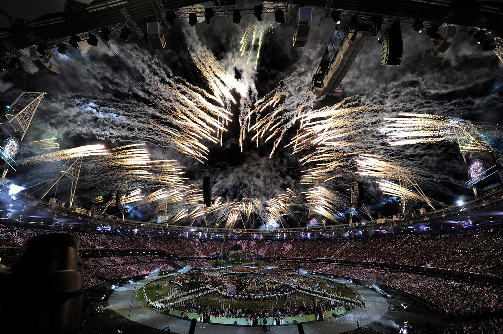 Description of . Fireworks illuminate the stadium during opening ceremonies  Friday, July 27 2012 at Olympic Stadium. John Leyba, The Denver Post
