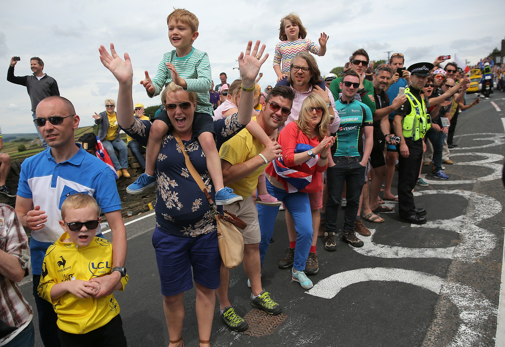 Description of . SHEFFIELD, ENGLAND - JULY 06:  Fans crowd the sides of the course as they support the riders during stage two of the 2014 Le Tour de France from York to Sheffield on July 6, 2014 in Sheffield, United Kingdom.  (Photo by Doug Pensinger/Getty Images)