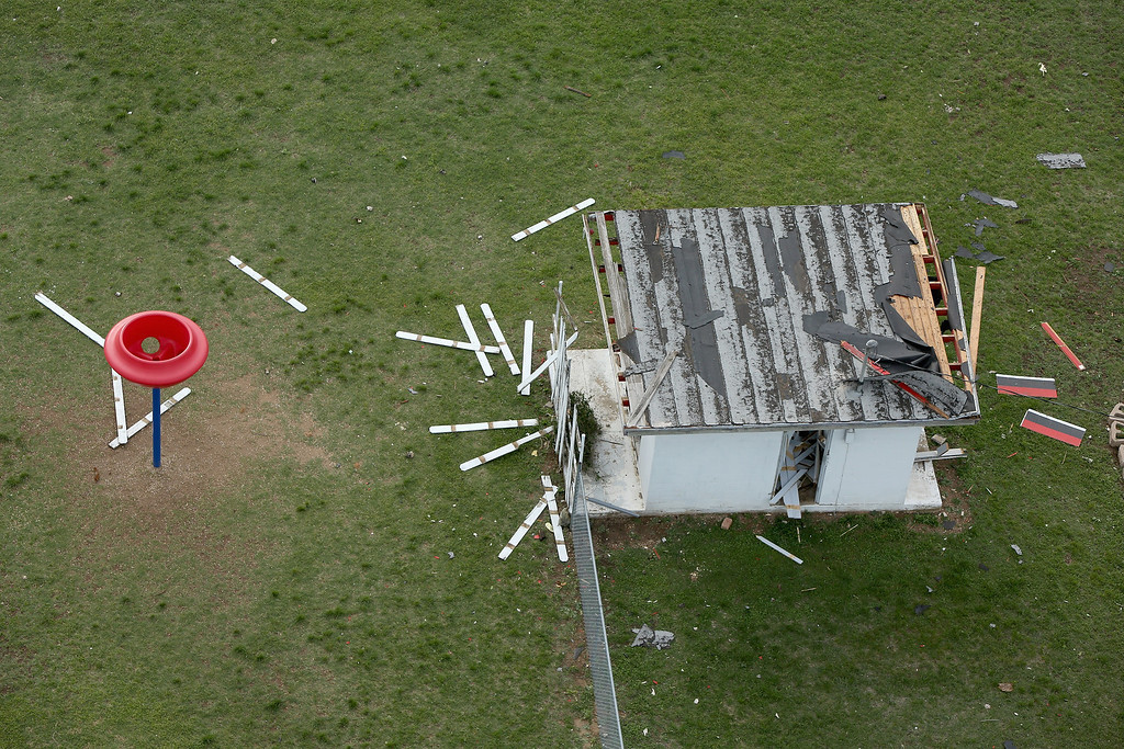 Description of . WEST, TX - APRIL 18:  Playground equipment and a shed damaged by an explosion Wednesday at the West Fertilizer Company shown from the air on April 18, 2013 in West, Texas. According to West Mayor Tommy Muska, around 14 people, including 10 first responders, were killed and more than 150 people were injured when the fertilizer company caught fire and exploded, leaving damaged buildings for blocks in every direction.  (Photo by Chip Somodevilla/Getty Images)