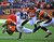 Denver Broncos cornerback Champ Bailey (24) and Denver Broncos outside linebacker Wesley Woodyard (52) tackle Kansas City Chiefs running back Shaun Draughn (20) in the first quarter as the Denver Broncos took on the Kansas City Chiefs at Sports Authority Field at Mile High in Denver, Colorado on December 30, 2012. Tim Rasmussen, The Denver Post
