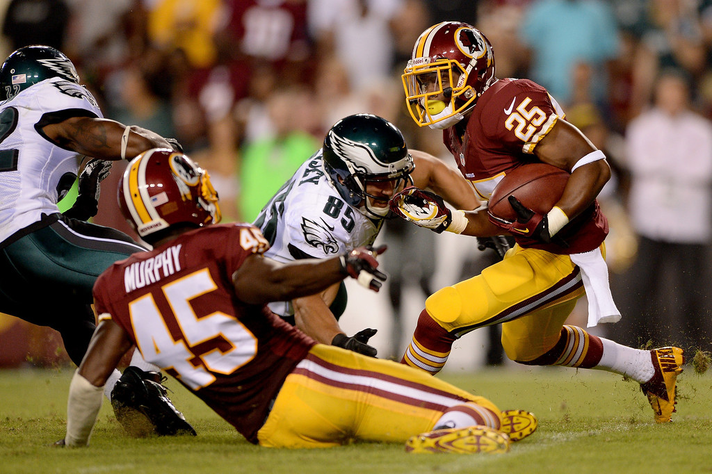 Description of . Chris Thompson #25 of the Washington Redskins returns a punt as tight end James Casey #85 of the Philadelphia Eagles goes for a tackle in the second quarter at FedExField on September 9, 2013 in Landover, Maryland.  (Photo by Patrick Smith/Getty Images)