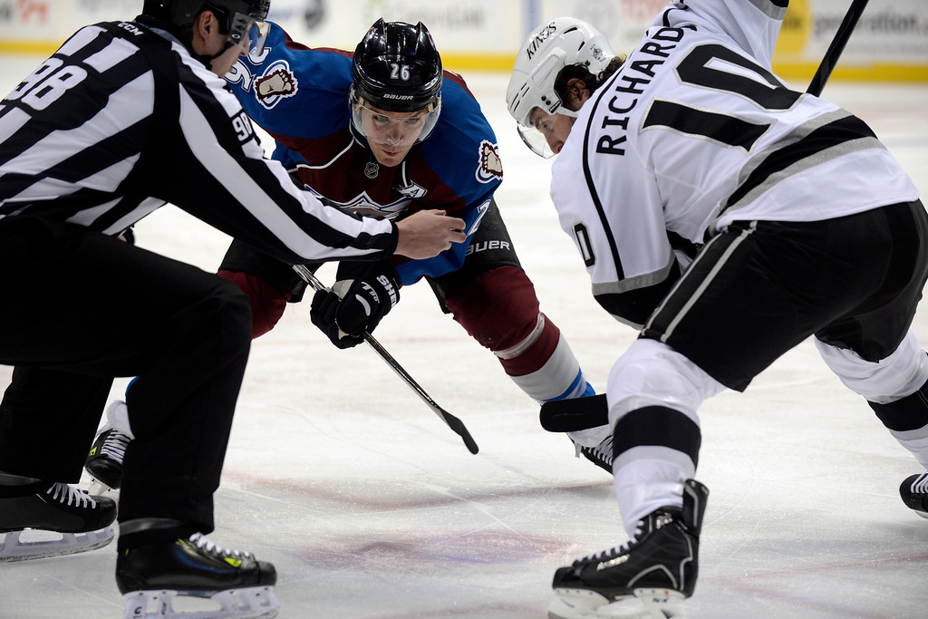 Description of . DENVER, CO. - JANUARY 22: Colorado Avalanche center Paul Stastny (26) faces off with Los Angeles Kings center Mike Richards (10) during the first period. The Colorado Avalanche hosted the Los Angeles Kings at the Pepsi Center on January, 22, 2013.    (Photo By John Leyba / The Denver Post)