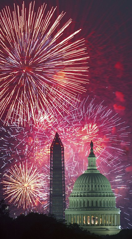 Description of . Fourth of July US Independence Day fireworks are seen over the US Capitol and Washington Monument July 4, 2013 in Washington, DC    PAUL J. RICHARDS/AFP/Getty Images