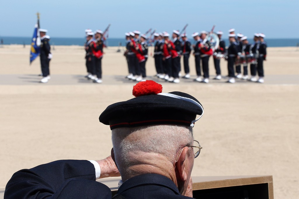 Description of . A French veteran commando squad of the French navy, stand, on June 6, 2014, on the beach in Ouistreham prior to attend the ceremony of the D-Day commemorations, marking the 70th anniversary of the World War II Allied landings in Normandy. AFP PHOTO / LUDOVIC MARIN/AFP/Getty Images