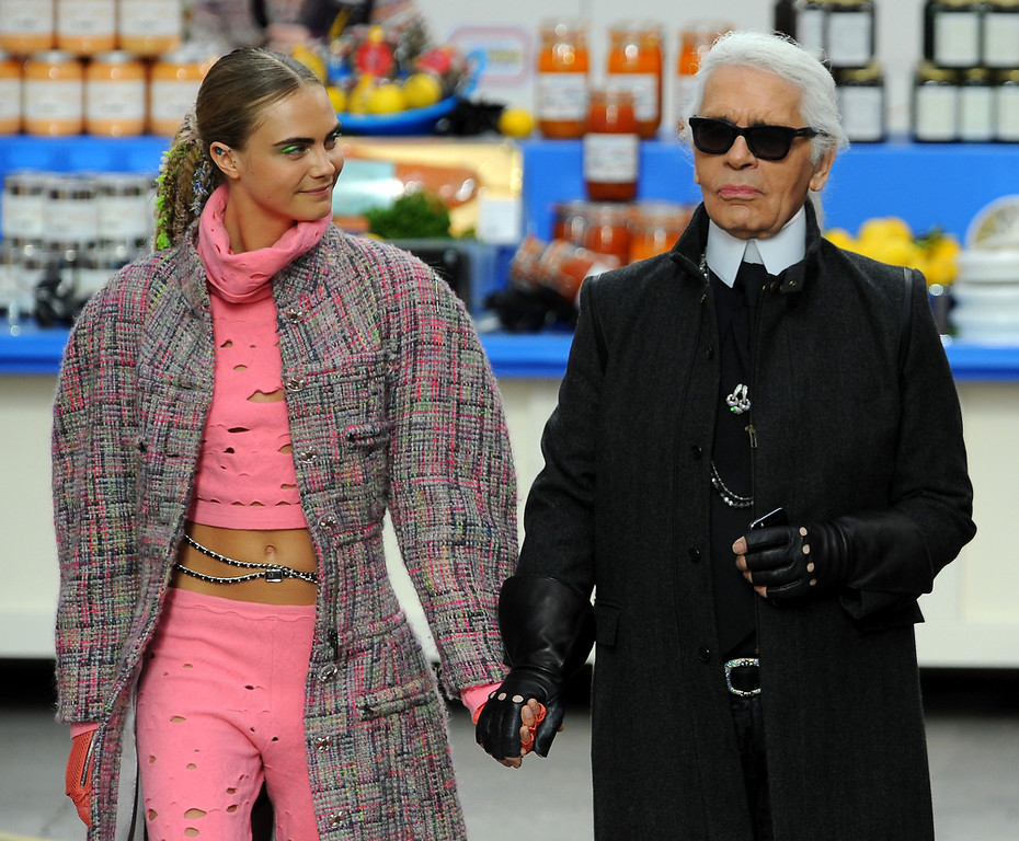 Description of . Fashion Designer Karl Lagerfeld and model Cara Delevingne appear at the end of the runway during the Chanel show as part of the Paris Fashion Week Womenswear Fall/Winter 2014-2015 on March 4, 2014 in Paris, France.  (Photo by Francois Durand/Getty Images)