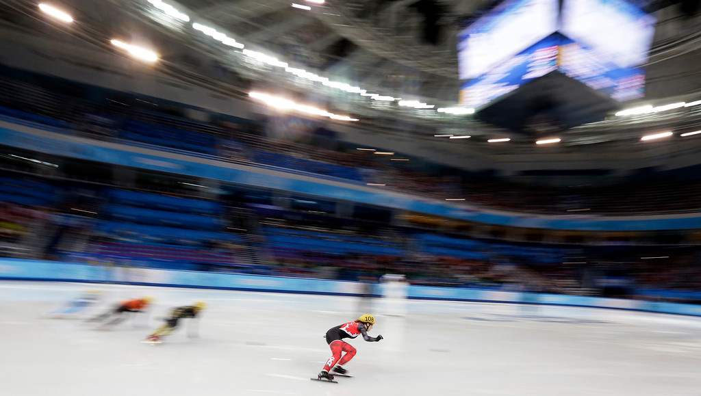 . Marianne St-gelais of Canada competes in a women\'s 500m short track speedskating heat at the Iceberg Skating Palace during the 2014 Winter Olympics, Monday, Feb. 10, 2014, in Sochi, Russia. (AP Photo/Darron Cummings)