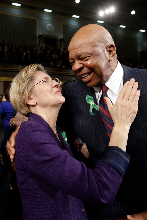 Description of . Sen. Elizabeth Warren (D-MA) (L) talks with Rep. Elijah Cummings (D-MD) (R) on Capitol Hill on February 12, 2103 in Washington, D.C. Facing a divided Congress, Obama is expected to focus his speech on new initiatives designed to stimulate the U.S. economy. (Photo by Charles Dharapak-Pool/Getty Images)