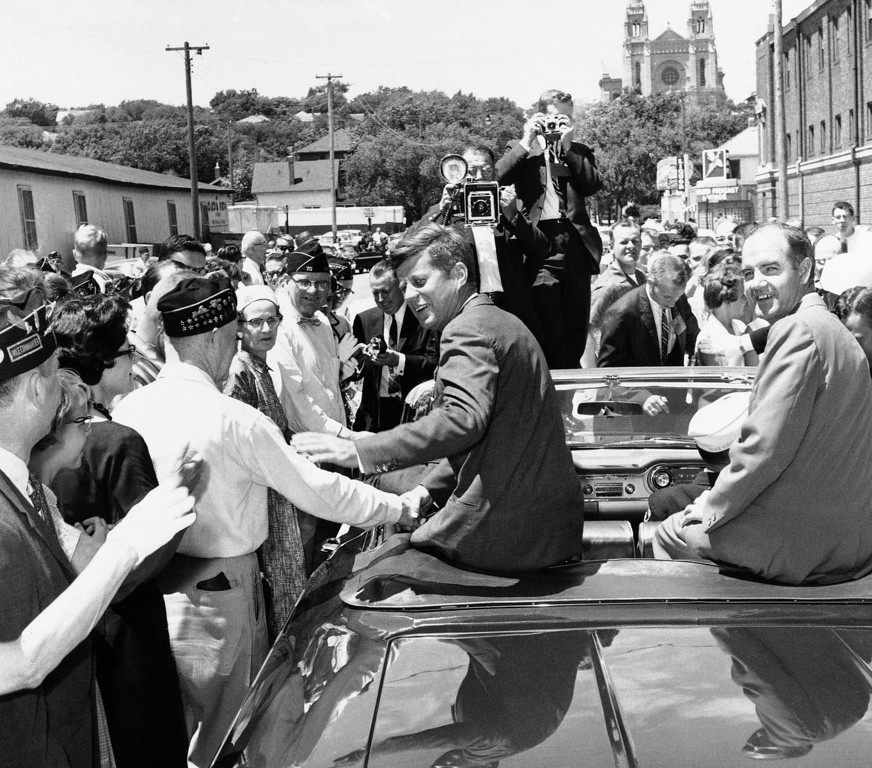 Description of . George McGovern, then a congressman, joined Sen. Kennedy on the campaign trail in June 1960. Both went on to victory, Kennedy as president and McGovern as senator. Picture, they greet a crowd in Sioux Falls, S.D. Associated Press file