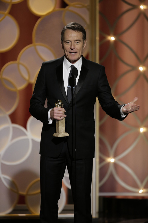 "Description of . In this handout photo provided by NBCUniversal, Bryan Cranston accepts the award for Best Actor in a TV Series, Drama for ""Breaking Bad\""  during the 71st Annual Golden Globe Award at The Beverly Hilton Hotel on January 12, 2014 in Beverly Hills, California.  (Photo by Paul Drinkwater/NBCUniversal via Getty Images)"