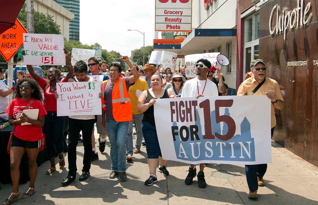 Description of . People who support the fast food workers strike march along Guadalupe Street in Austin,Texason Thursday Aug. 29, 2013.   (AP Photo/Austin American-Statesman, Jay Janner)