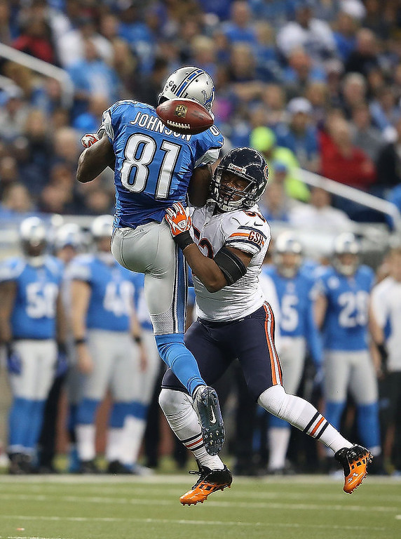 Description of . Nick Roach #53 of the Chicago Bears breaks up the pass intended for Calvin Johnson #81 of the Detroit Lions during the game at Ford Field on December 30, 2012 in Detroit, Michigan. The Bears defeted the Lions 26-24.  (Photo by Leon Halip/Getty Images)
