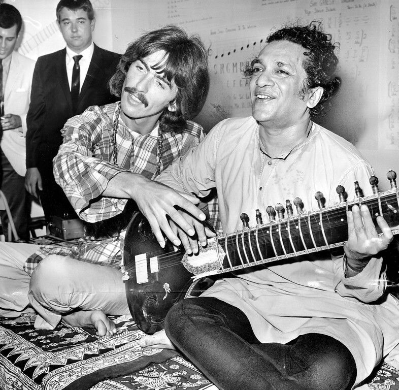 . Sitarist Ravi Shankar, right, in a 1967 file photo with Beatles guitarist George Harrison. Shankar died on Tuesday, December 11, 2012. (John Malmin/Los Angeles Times/MCT)