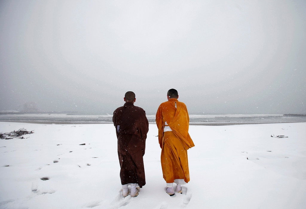 Description of . Buddhist monks offer prayers for victims of the March 11, 2011 earthquake and tsunami at Kitaizumi beach in Minamisoma, Fukushima prefecture, some 25 km (15 miles) from the tsunami-crippled Fukushima Daiichi nuclear power plant March 10, 2012, a day before the disaster's one-year anniversary. The magnitude 9.0 earthquake on March 11 last year unleashed a tsunami that killed about 16,000 and triggered the world's worst nuclear crisis since Chernobyl. About 326,000 people are still homeless and nearly 3,300 remain unaccounted for.   REUTERS/Yuriko Nakao