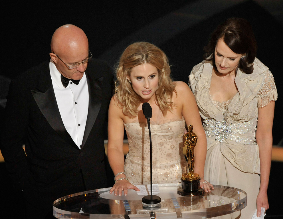 Description of . Kate Ledger (C), sister of late Heath Ledger, accepts the award for Best Supporting Actor for